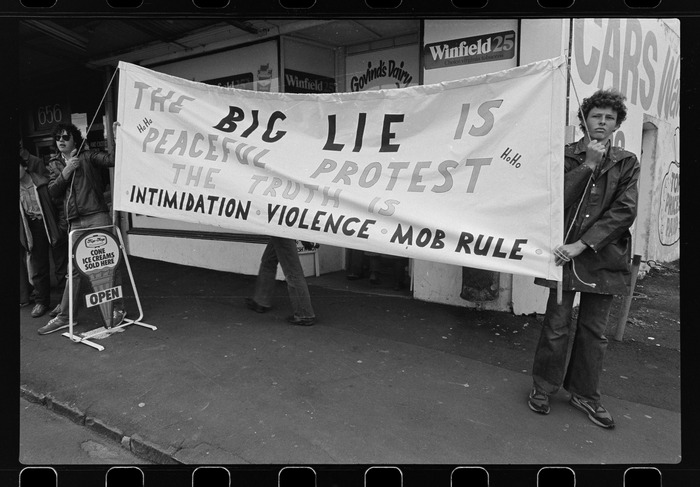 """Counter-protesters with sign beginning """"The BIG LIE"""""""