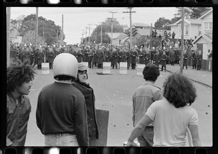 Protesters facing police in a street