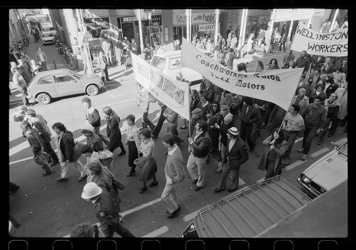 View from above of protest marchers with union banners walking past James Smith's, Wellington
