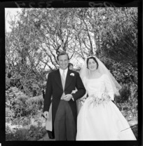 Wedding portrait of James Hutchison and Margot Todd in unidentified garden on the day of their wedding