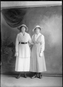Studio portrait of two unidentified women, both wearing gloves, probably Christchurch district