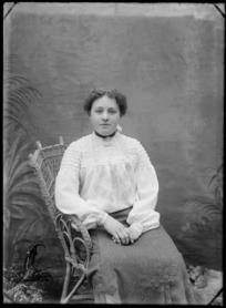 Portrait of unidentified woman, wearing an embroidered blouse and skirt, probably Christchurch district