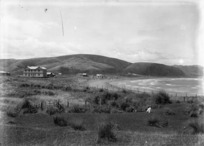 View of the beach at Plimmerton, showing Plimmerton House on the left