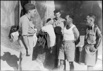 Repatriated New Zealand prisoners of war meet and compare experiences at Maadi Camp, Egypt - Photograph taken by George Robert Bull