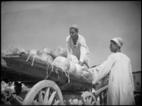 Two locals with a cartload of melons in the melon market, Cairo - Photograph taken by George Kaye