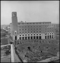 Roman amphitheatre and a modern building in the Italian town of Lecce, World War II - Photograph taken by George Kaye
