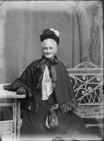 Studio portrait of unidentified older woman wearing cape and gloves, probably Christchurch