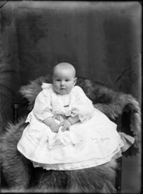 Studio portrait of unidentified baby in white lace dress, probably Christchurch