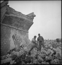 Engineers working on the ruins of bridge demolished by Germans in Italy, World War II - Photograph taken by George Kaye