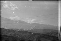Smoke from Allied bombs landing on German positions at Guardiagrele on the Italian Front, World War II - Photograph taken by George Kaye