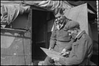 Captain J S Rutherford, Intelligence officer NZ Artillery, conferring with Captain A G Dick about reconnaissance flight, Italian Front, World War II - Photograph taken by George Kaye