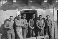 Two local residents with group of New Zealanders billetted in Italian village, World War II - Photograph taken by George Kaye