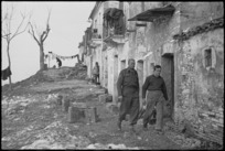 One of the streets in a village where New Zealand Division troops are resting, Italy, World War II - Photograph taken by George Kaye