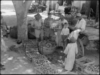 Two NZ soldiers buying vegetables and fruit in Cairo for the officers' and sergeants' messes in Cairo during World War II - Photograph taken by George Kaye