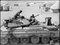 Men at 4th Armoured Brigade workshops in Maadi, Egypt, working on a Crusader tank - Photograph taken by George Kaye