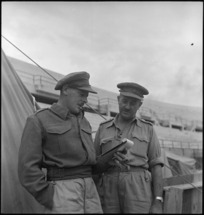Major Ian Stock confers with Brigadier S H Crump in Italy, World War II - Photograph taken by George Kaye