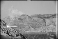 Thick clouds of smoke and dust from bombing obscures Benedictine Monastery at Cassino, Italy, World War II - Photograph taken by George Kaye
