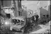 NZ truck negotiating rubble in main street of the village of Mignano in Italy during World War II - Photograph taken by George Kaye