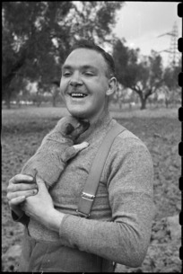 Private E R Hiscoke and puppy mascot Ace at the NZ Reinforcement Transit Unit, Italy, World War II - Photograph taken by George Bull
