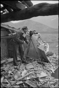 Photographer M D Elias at work in the Monte Cassino area, Italy, World War II - Photograph taken by George Kaye