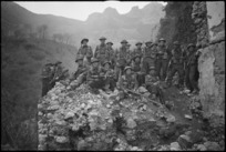 Platoon of New Zealand Infantry soldiers on the ruins of a village in Cassino area, Italy, World War II - Photograph taken by George Kaye