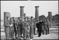 Guide points out to New Zealand soldiers on leave some features of Pompei, Italy, World War II - Photograph taken by George Kaye
