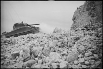 NZ Sherman tank among ruins of village on the Cassino Front, Italy, World War II - Photograph taken by George Kaye