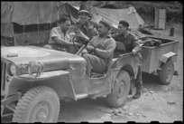 Members of the Maori Battalion with their trailer jeep at Hove Dump, near Cassino, Italy, about to load supplies - Photograph taken by George Bull