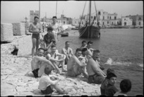 Patients at 1 NZ Convalescent Depot swimming off the breakwater at Santo Spirito, Italy, World War II - Photograph taken by George Bull