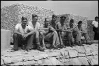 New Zealanders enjoying sun on the breakwater near 1 NZ Convalescent Depot at Santo Spirito, Italy, World War II - Photograph taken by George Bull