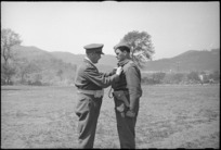 Lieutenant Colonel H M McElroy receiving bar to his DSO from General Freyberg at parade in Volturno Valley, Italy, World War II - Photograph taken by George Kaye