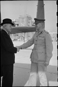 Prime Minister Peter Fraser greeted by Brigadier W G Stevens at an airport near Naples, Italy, World War II - Photograph taken by George Bull