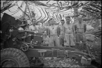 Gun crew of one of the guns of NZ Divisional Artillery in the Cassino area, Italy, World War II - Photograph taken by George Kaye