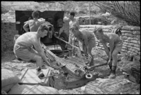 NZ Divisional Artillery gunners moving their gun in the Cassino area, Italy, World War II - Photograph taken by George Kaye