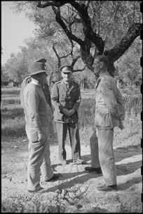 Prime Minister Peter Fraser with Generals Freyberg, Puttick and Lieutenant General Sir Richard McCreery in Italy, World War II - Photograph taken by George Bull