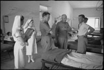 Prime Minister Peter Fraser talking with staff at 2 New Zealand General Hospital, Caserta, Italy, World War II - Photograph taken by George Kaye