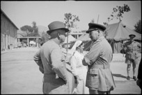 Prime Minister Peter Fraser talks to General W C Hartgill at 2 New Zealand General Hospital, Caserta, Italy, World War II - Photograph taken by George Kaye