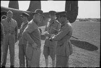 Prime Minister Peter Fraser with military personnel at Bari Airport, Italy, World War II - Photograph taken by George Bull