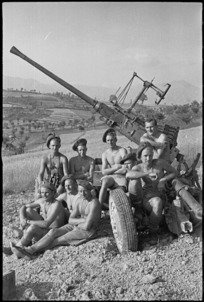 New Zealand anti aircraft gunners rest beside their gun in the Sora area, Italy, World War II - Photograph taken by George Kaye