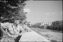 New Zealanders looking across a River from the town of Sora, Italy, World War II - Photograph taken by George Kaye
