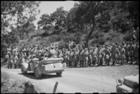 Car carrying King George VI passes through lines of New Zealanders during visit to the NZ Division in Italy, World War II - Photograph taken by George Kaye