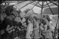 Tuis on leave in Rome buy flowers from stand in Piazza di Spagna, World War II - Photograph taken by George Kaye