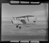 De Havilland DH 83 Tiger Moth biplane, ZK-AIN, in flight, Auckland Region