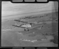 De Havilland DH 83 Tiger Moth biplane ZK-AIN, in flight, Auckland Region