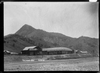 Main Road, Tokomaru Bay, East Coast, showing Farmers Ltd and the tailoring business of H Paterson