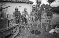 Kaye, George, b 1914 (Photographer) : Unidentified World War 2 soldiers of the Maori Battalion on bicycles at Gambettola, Italy