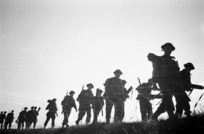 Kaye, George, 1914- : NZ infantrymen moving into the forward postions at dusk, near the Lamone River, Italy