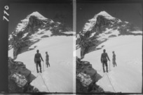 Edgar Williams' Mount Aspiring trip, two unidentified mountaineers roped-up on the Northwest Ridge of Mount Aspiring with the summit beyond, Central Otago Region