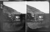 Edgar Williams' Mount Aspiring trip, unidentified men with car and tent camping on an unknown high country road, Central Otago Region