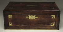 [Maker unknown] :[Wooden writing desk with brass fittings, formerly the property of J. F. Hoggard, Wellington's second postmaster. Made in the mid-nineteenth century?] [Closed view, square on]